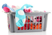 Plastic basket with socks isolated on white — Stock Photo