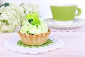 Tasty cake on table on light background — Stock Photo