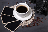 Coffee cup, vintage camera and old blank photos, on wooden background — Foto Stock