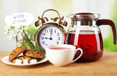 Tasty herbal tea and cookies on wooden table — Zdjęcie stockowe