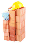 New bricks and building tools, isolated on white  — Stock Photo