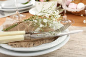 Table setting with spring flowers close up — Stockfoto