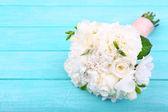 Beautiful wedding bouquet on wooden background — Stock Photo