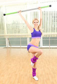 Sporty woman doing exercises in gym — Стоковое фото