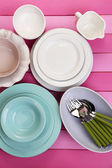 Different tableware on wooden table — Stock Photo