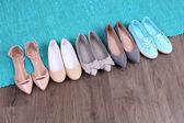 Female fashion shoes on blue carpet  — ストック写真