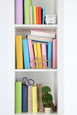 Books on white shelves in room — Stock Photo