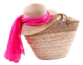 Wicker bag with hat and colorful scarf, isolated on white — Stock Photo