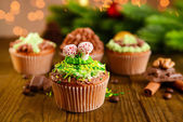 Tasty cupcakes with butter cream, on  wooden table, on bright background — Stok fotoğraf