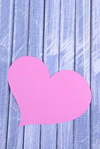 Paper hearts on wooden  background — Stock Photo