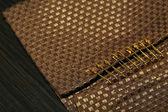 Safety pins on fabric background — Stok fotoğraf