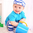 Cute little boy with toy bucket — Stock Photo