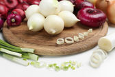 Different raw onion, isolated on white — Stock Photo