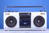 Retro cassette stereo recorder on table on blue background — Stock Photo
