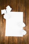 Sheet of white paper with crumpled  paper  and pencil on table close-up — Stockfoto