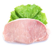 Raw meat steak with leaf lettuce, isolated on white — Stock Photo