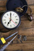 Repair clock on wooden background — Stock Photo