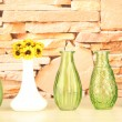 Different decorative vases on shelf on brick wall background — Stock Photo #45629701