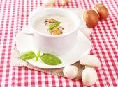 Mushroom soup in white pot, on napkin background — Stock Photo