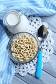 Homemade yogurt and delicious  cereals in bowl on wooden table background — Stock Photo