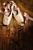 Ballet pointe shoes on wooden background — Foto Stock