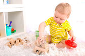 Little boy with wooden toy — Stock Photo
