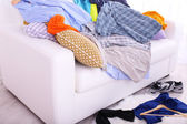 Messy colorful male clothing on  sofa on light background — ストック写真