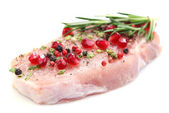 Raw meat steak with herbs, spices and pomegranate seeds, isolated on white — Stock Photo