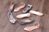 Different shoes on floor — Foto de Stock