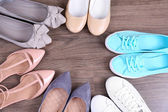Different shoes on floor — Stock Photo