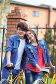 Young couple with bicycles outside — Stock Photo