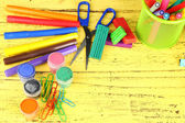 Composition of various creative tools  on color wooden background — Stockfoto