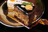 Assortment of pieces of cake, on dark background — Stockfoto
