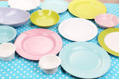 Different tableware on tablecloth — Stock Photo