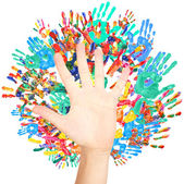 Hand and colorful handprints isolated on white — Stock Photo