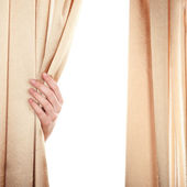 Hand opening curtain on white background — Stock Photo