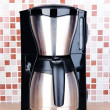Постер, плакат: Coffee maker in kitchen on table on mosaic tiles background