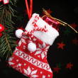 Santa sock and Christmas accessories on black background with lights — Stock Photo #45904995