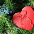 Heart - gift box on Christmas tree background, close-up — Stock Photo #45905155