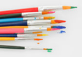 Paint brushes with gouache isolated on white — Stock Photo