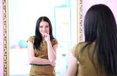 Woman in front of mirror — Stock Photo