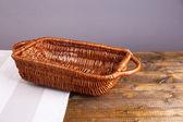 Empty wicker basket on wooden table, on dark background — Stock Photo