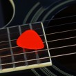 Colourful plectrum on guitar, close up — Stock Photo #45951567