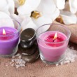 Composition with beautiful colorful candles, sea salt and orchid flowers, on wooden background — Stock Photo