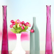 Different decorative vases on shelf on light background — Stock Photo #45951755