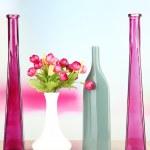 Different decorative vases on shelf on light background — Stock Photo