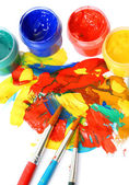 Abstract gouache paint and brushes, isolated on white — Stock Photo