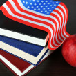 Composition of American flag, books and apple on wooden table background — Stock Photo #46188937