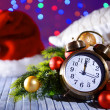 Composition with retro alarm clock and Christmas decoration on bright background — Stock Photo #46189205