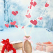 Decorative branch with hearts, on winter background — Stock Photo